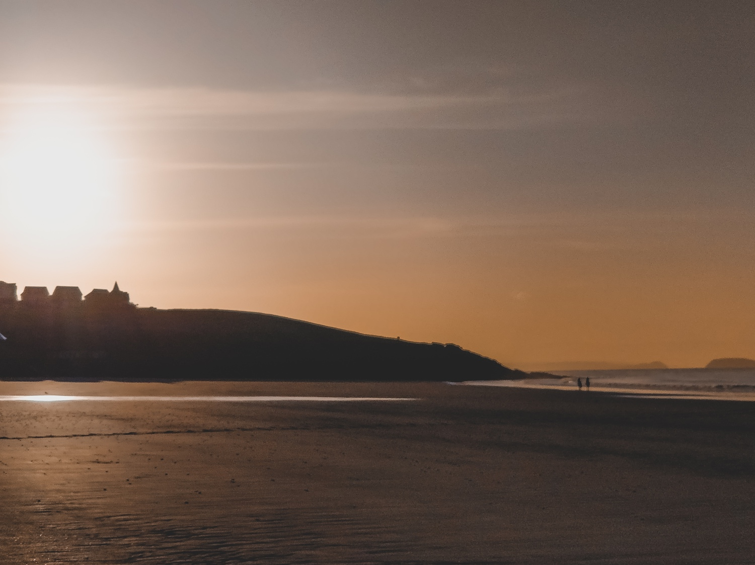 The sun rising over the headland