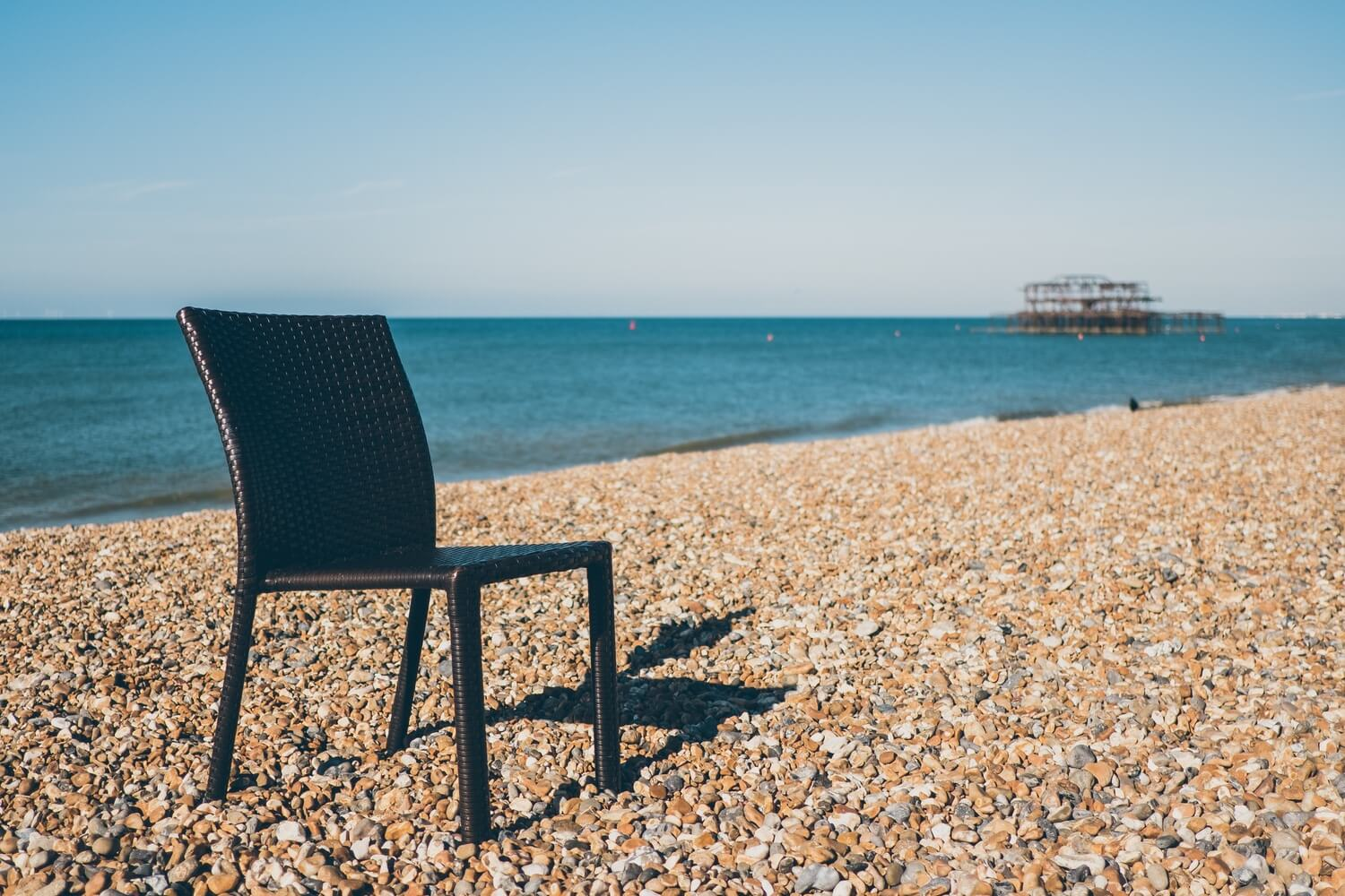 A stray chair left on Brighton beach