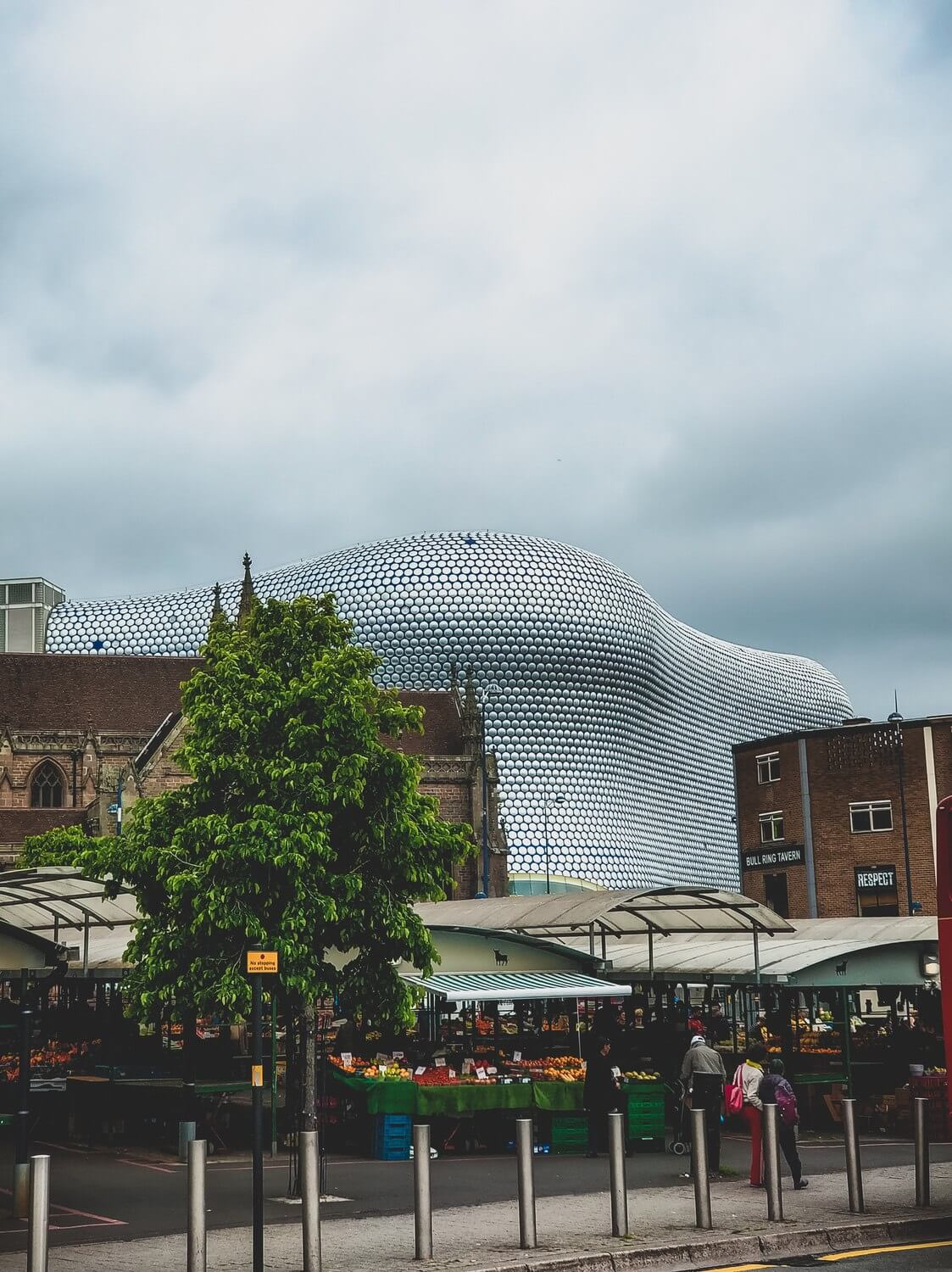 Looking through a market to the bullring building.
